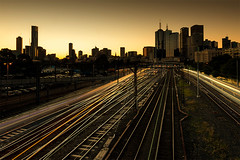 Into the City (Leanne Cole) Tags: city sunset skyline architecture cityscape photographer photos australia melbourne blurred trains images victoria environment fineartphotography architecturalphotography trainlines cityofmelbourne environmentalphotography fineartphotographer architecturalphotographer environmentalphotographer leannecole leannecolephotography