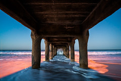 Dawn Under The Pier (Kurt Lawson) Tags: ocean california morning beach water night sunrise dawn pier sand waves pacific under spray pilings underneath manhattanbeach pillars crashing pilars