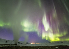 Fumeroles and Aurora Borealis (Gabriela Iacobuta) Tags: winter sky snow cold green ice night stars frozen photographer purple ngc aurora volcanic northernlights borealis volcanos feezing 5photosaday fumeroles