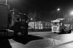 Face Off (John fae Fife) Tags: nightphotography blackandwhite bw monochrome night lorry trucks luxembourg lorries howald