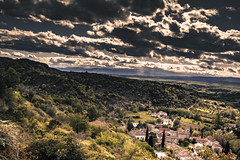 Rochecolombe nuageuse (Kevin STRAGLIATI) Tags: travel light vacation sky sun sunlight mountain plant france green nature clouds forest trek canon landscape spring europe day village cloudy hiking south country hill hike campaign ardeche rochecolombe