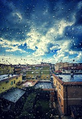 Rainy day (Alessandro Cuomo) Tags: sky italy window colors rain clouds buildings daylight town flickr italia nuvole finestra cielo raindrops townscape pioggia gocce sabaudia sigma1020mm canoneos600d