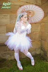 IMG_9343 (Neil Keogh Photography) Tags: pink flowers blue white green abbey graveyard yellow dreadlocks female umbrella fence shoes purple candy boots lace bra gothic goth goggles trainers tattoos gloves corset braids spikes gravestones tutu choker cybergoth whitbyabbey dogcollar fishnettights whitbygothweekend fishnettop april2016