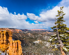 Bryce Canyon 19 (MarcCooper_1950) Tags: trees red sky orange snow colors clouds landscape utah nikon scenery rocks vivid canyon cliffs hills southern boulders hoodoo bryce rainfall hdr formations lightroom mounatins brycecanyonnationalpark geologic d810 marccooper