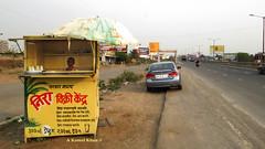 Somewhere in India (A Kamal Khan) Tags: road street travel india shop train highway asia tour traffic indian khandala vendor maharashtra roadside mumbai lonavala canonpowershot shopkeeper abkamalkhan sx50hs akamalkhan