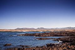 Fuerteventura, Canary Islands (pas le matin) Tags: ocean voyage travel sea sky cloud mer seascape beach water canon landscape island islands coast seaside outdoor canarias cte shore 7d paysage plage atlanticocean canaryislands isla islas les islascanarias le canoneos7d puntadelaballena puntadetoston 287149814014117canaryislands