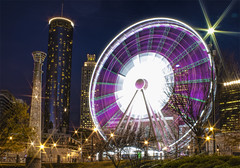 Skyview Ferris Wheel (Mark Chandler Photography) Tags: street plaza city longexposure atlanta sunset color colour building fountain skyline night ga buildings georgia photography lights hotel photo nightlights atl stock rings ferriswheel olympic streetcar westin peachtree centennialpark skyview centennialolympicpark nightscenes lightstream markchandler connectdowntown