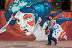 The Painted Streets, Bogota (Geraint Rowland Photography) Tags: streetart art face angel canon walking graffiti thestreets couple colombia bogota candid paintings streetphotography walkers paintedface travelinsouthamerica laestrellapolar streetartandgeraintrowlandphotography