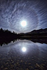 m00n glow (John Andersen (JPAndersen images)) Tags: trees moon lake mountains night clouds reflections halo aurora bowvalleypark