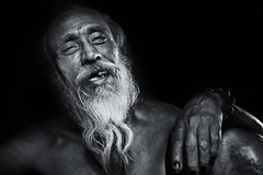 Sadhu Series, Five (Axel Halbgebauer) Tags: street nepal portrait people blackandwhite india black face closeup blackbackground zeiss laughing beard happy prime blackwhite lowlight hands funny hand candid sony religion streetphotography wideangle headshot kathmandu hindu hinduism sadhu holyman southasia expresssion saarc sonyalpha streetportait sonyimages distagon3514za sonya7r2