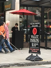 Vision impaired pedestrian walking downtown + Valet parking sign (Seattle Department of Transportation) Tags: seattle sign cane downtown blind pedestrian transportation walkers valet visionimpaired sdot