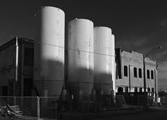 Three Silos (geowelch) Tags: toronto abandoned blackwhite silo urbanlandscape libertyvillage urbanfragments industrialarchitecture newtopographics olympusomdem5 panasoniclumixvario1445mm