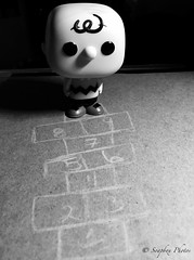 Big Head Chuck One Object Photo Challenge - day 10, Hopscotch is not for the faint of heart (Soapbox Girl (Carol Anne)) Tags: toy toys actionfigure peanuts charliebrown hopscotch funko iphone oneobject noirfilter iphonephoto theyearofcharliebrown oneobjectchallenge oneobjectphotography