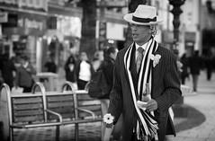 As never seen before (Just Ard) Tags: street people blackandwhite bw white man black flower blancoynegro monochrome face hat smart scarf person photography mono nikon dof noiretblanc zwartwit ninja candid cardiff 85mm depthoffield d750 unposed  biancoenero schwarzundweis
