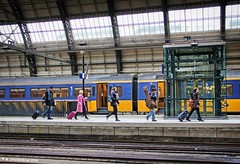 Passengers, Centraal Station, Amsterdam, The Netherlands (PhotosToArtByMike) Tags: holland netherlands dutch amsterdam train centercity railwaystation passenger centrum amsterdamcentraal centralrailwaystation northholland
