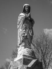 Calvary Cemetery (Gabrielle Gaia) Tags: blackandwhite sculpture cemetery grave graveyard statue illinois catholic tombstone il gravestone springfield virginmary calvarycemetery catholiccemetery