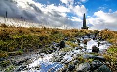 Stoodley Pike (MichikoSmith) Tags: bridge blue sky west monument clouds landscape nikon angle outdoor yorkshire hill wide peak tokina pike hebden calderdale stoodley dodmorden