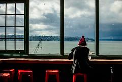 lunch break (ewitsoe) Tags: ocean seattle street city windows sea urban storm man water ferry clouds 35mm island coast nikon hipster redhat sound pugetsound pikeplacemarket windwo unch 2035mm d80 ewitsoe