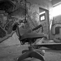 The Lonely Chair (.:Axle:.) Tags: bw slr industry 120 6x6 film mediumformat square blackwhite nc rust ruins industrial factory fuji kodak stock northcarolina hasselblad urbanexploration leftovers fujifilm neopan powerplant ue mamu acros urbex xtol acros100 filmphotography fujiacros100 oldfort filmisnotdead hasselblad500c filmisalive kodakxtol carlzeissdistagon50mm14 believeinfilm mamuviii mamu8