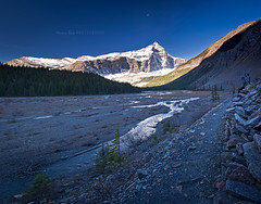 Mount Robson.. Between night and day (Marina Bass (back in NY)) Tags: ca morning camping autumn trees lake snow canada mountains reflection fall nature sunrise trekking reflections rockies outdoors nationalpark bc hiking britishcolumbia north tranquility peak lookout calm glacier fallfoliage pines backpacking mountaineering summit northamerica destination backcountry robson rockymountains serene range epic pristine mountrobsonprovincialpark environments canadianrockies torquoise glaciallake mistglacier