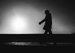 Into The Light (Dan-Schneider) Tags: street camera trip light shadow sea people blackandwhite bw beach silhouette photography prime candid streetphotography olympus scene best moment schwarzweiss decisive schneider 17mm mft einfarbig omdem10