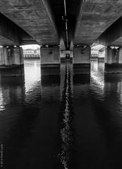linear reflection (D-j-L) Tags: bridge blackandwhite bw reflection water monochrome canon river unitedkingdom belfast line gb northernireland trucks lorries lagan s100