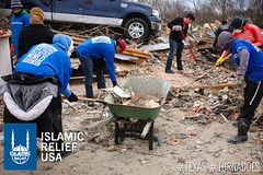 IRUSA disaster response team members pick up rubble from destroyed homes caused by the tornado in Texas.