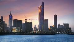 Sunset (khalid almasoud) Tags: city sunset sea buildings landscape flickr sony towers e estrellas kuwait    greatphotographers  55210mm sonya5100 ilce5100