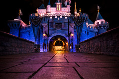 A Walk Through Wonderland *Explored 1/27/2016* (NOLA_2T) Tags: longexposure blue red brick castle yellow stone night photoshop lights pod nikon raw gorilla princess walk disneyland tripod sigma disney walkway land jpg 1020mm walt 1020 edit lightroom sleepingbeautycastle sigma1020mm d90 joby sigma1020 cs6 gorillapod wigma