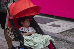 apathetic (edwardpalmquist) Tags: street city shadow urban baby bird fashion japan tokyo kid child stroller shibuya blanket harajuku owl