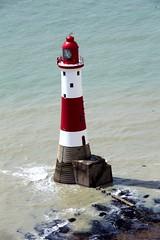 Beachy Head Lighthouse and blue sea (Heaven`s Gate (John)) Tags: blue red sea england lighthouse white english history beach water sussex coast rocks head deep cliffs channel beachy johndalkin heavensgatejohn