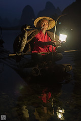 Nightfall in XingPing 037A9992 (lycheng99) Tags: china old nightphotography blue red portrait man mountains reflection bird water lamp birds night reflections river cormorants liriver fishing fisherman quiet guilin bluesky bamboo cormorant raft bluehour karst nightvision bambooraft xingping chinatravel quietnight ljing karstformation