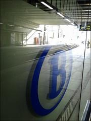 B comme Bon voyage! (chando*) Tags: brussels reflection belgium belgique gare cellphone bruxelles railway railwaystation reflet nmbs chemindefer sncb gareschuman