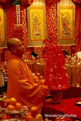 Monk - Buddha Tooth Relic Temple Singapore (WanderingPhotosPJB) Tags: orange colour temple singapore monk buddhism oranges colourful toothrelic buddhatoothrelictemple cmwdorange