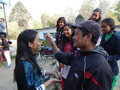 Aakriti getting painted (rukmini_foundation) Tags: nepal colors celebration holi didi mentoring