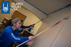 Islamic Relief USA volunteers paint a classroom for the MLK Day of Service 2016.