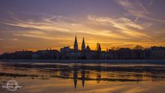 Szeged sunset (Malki96) Tags: sky orange cloud reflection water architecture canon buildings lens eos gold hungary kitlens kit szeged t3i 18mm suncity dm magyarorszg tisza 600d