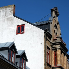 Facades in spring (fabiankoppers) Tags: old city roof house lund window stone wall facade square sweden geometry retro