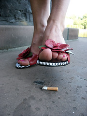 Ananda crushing her cigarette (sunnystreets) Tags: street city pink feet public female outdoors foot shoes toe sandals cigarette jewellery pedicure crush polished