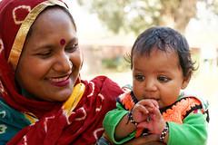 Mother's love (marko.erman) Tags: portrait india color love smiling eyes child delhi sony joy mother