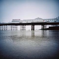 Brighton Pier at low tide (lomokev) Tags: green beach lomo brighton westpier brightonpier palacepier lomogaphy lca120 lomolca120 roll:name=150701lomolca120lomocn400 file:name=150701lomolca120lomocn400000002