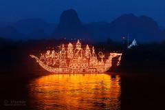 illuminated_boat_procession_02r (khunkay's gallery) Tags: boat 15 11 illuminated procession 2558 พระจันทร์ พลุ นครพนม เดือน ขึ้น พญานาค ออกพรรษา ธาตุพนม ค่ำ นาแก ศรีสงคราม เรณูนคร ประเพณีไหลเรือไฟ เลียบริมฝั่งแม่น้ำโขง ถนนสุนทรวิจิตร ขบวนเรือไฟ ลำน้ำโขง พาแลง ลอยเรือไฟ วัดโพธิ์ศรี ท่าอุเทน นาหว้า บ้านแพง ปลาปาก โพนสรรค์ วังยาง นาทม