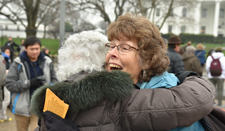 Peace Activists Helen Schietinger and Eve Tetaz Embrace