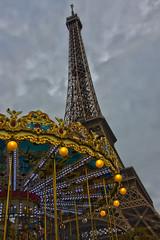 Carousel & Eiffel Tower (Kevin MG) Tags: travel paris france cloudy eiffeltower carousel hdr