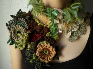 knitted and crocheted statement scarflette in green, brown, cream, gray, burgundy, camel and yellow colors with floral decorations by irregularexpressions