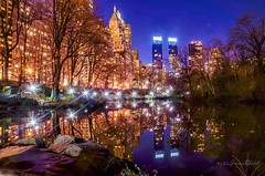Reflections of Time Warner Center reflected at The Pond, Central Park New York City. (mitzgami) Tags: nyc newyorkcity longexposure nightphotography newyork reflection landscape photography flickr centralpark timewarnercenter nikonphotography thepondcentralpark lazyshutter