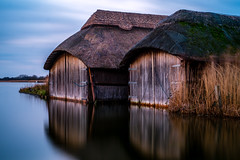Hickling Boat Houses (Neal_T) Tags: uk longexposure winter 35mm fuji norfolk norwich fujifilm thatchedroof boathouse norfolkbroads xe1 10stop hicklingbroads