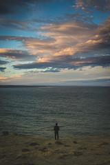 contemplacin (Lucrecia Carosi) Tags: boy sunset portrait sky santacruz man water argentina clouds atardecer person mar agua retrato cielo espalda nubes sur hombre acantilado contemplation puertosanjulin