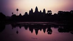 Sunrise over Angkor Wat (johnnyarmaosphotography) Tags: reflection history backlight sunrise ruins asia cambodia southeastasia khmer religion buddhism angkorwat siemreap angkor hinduism purplesky kampuchea khmerempire