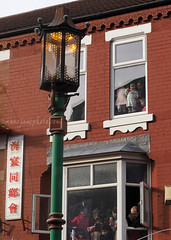 Nelson Street, Chinese New Year (.annajane) Tags: uk england people liverpool chinesenewyear celebration lamppost merseyside nelsonstreet